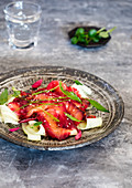 Salmon stewed with beetroot