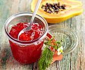 A jar of papaya and strawberry jam