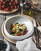 Zucchini noodles with black olives, cherry tomatoes and parmesan cheese (Keto)
