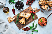 Mediterranean scones with spicy tomato spread on a wooden board