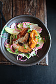 Porchetta with pickled red onion and apricot chutney