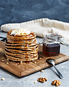 Banana walnuts pancakes with syrup