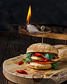 Burger with grilled halumi, tomatoes, chilli and basil