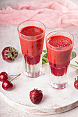 Summer blended strawberry smoothie juice in glasses