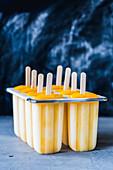 Homemade mango ice cream in plastic cups