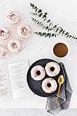Marble donuts with white icing, served with coffee