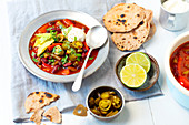 Vegetarian chili with avocado and sour cream
