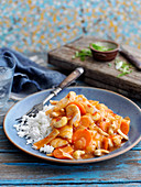 Firecracker chicken with carrots and rice (China)