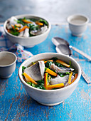 Healthy fish soup with carrots and pak choi (China)