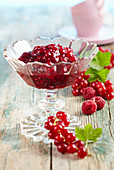 Raspberry and redcurrant jam in a glass bowl