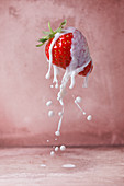 Strawberry with a milk splash