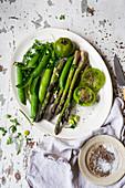 Oven baked green vegetables on a platter