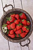 Fresh strawberries in a vintage metal cup