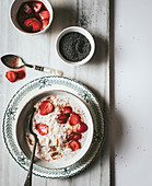 From above served oatmeal with strawberry and chia seeds