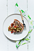 Grilled pork chop with coriander and chili vegetables