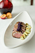 Pork fillet in nutmeg with red cabbage and potato parsley biscuits