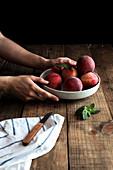 Tasty ripe peaches in plate