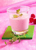 Milkshake with raspberries, lime, milk and mint
