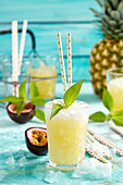 Jamaica Fever (cocktail with rum, brandy, passion fruit, pineapple, crushed ice and sage)