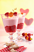 Raspberry smoothie with yoghurt, vanilla, cape gooseberries and mint