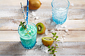 New Zealand mocktail with kiwi, coconut syrup, pineapple and lemon juice and blue curacao syrup