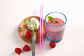 Summery raspberry shake with fresh fruits, honey, yoghurt and vanilla