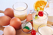 Golden Egg made from orange juice, milk, vanilla ice cream, egg yolk, lime and fruit skewer