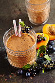 Homemade apricot berry smoothies with apple juice
