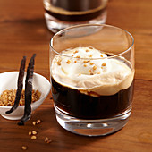 Hot Scottish coffee with whiskey, cream, sugar, brittle and vanilla