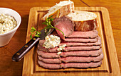 Cold roast beef in slices with baguette and remoulade sauce