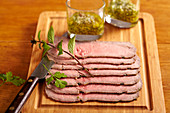 Cold sliced roast beef with salsa verde
