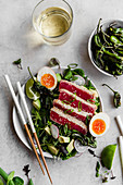 Seared tuna, with shisito peppers, watercress, and soft boiled eggs