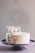 Vanilla buttercream cake decorated with flowers