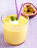 A mango and passion fruit smoothie with yoghurt, orange juice and honey