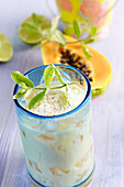 Caribbean smoothie with pineapple, mango, papaya, coconut and pineapple sage