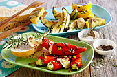 Grilled mini peppers filled with feta cheese, and grilled courgette with unleavened bread