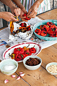 Preparing antipasti of paprika, zucchini and zucchini flowers
