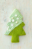 A shortbread Christmas tree with matcha powder and white chocolate