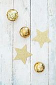 Stars and gold balls on festive surfacee