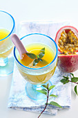 Hot passion fruit punch with white wine, honey, mandarins and mint