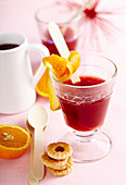 Non-alcoholic fruit Advent punch with orange, juice and cinnamon served with biscuits