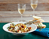 Grilled cod chop with risotto with king trumpet mushrooms, baguette and white wine