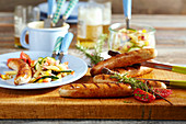 Grilled sausages with pasta salad and beer
