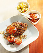 Grilled, marinated pork collar steak with tomato salsa and pineapple and chilli salsa