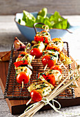 Grilled catfish skewers with peppers and tomatoes