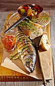 Whole grilled herb mackerel with red salsa, grilled vegetables and white bread