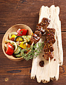 Oriental marinated grilled beef kebabs with grilled vegetables