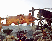 A whole grilled suckling pig on a spit, sausages, a horse, boiled potatoes and wine