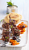 Espetada madeirense: beef skewers with sweet potato bread and Portuguese carrot salad