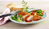 Grilled BBQ chicken breast with a bok choy salad and white bread